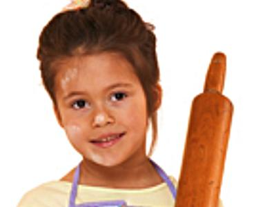 Little Girl in Apron Holding Rolling Pin