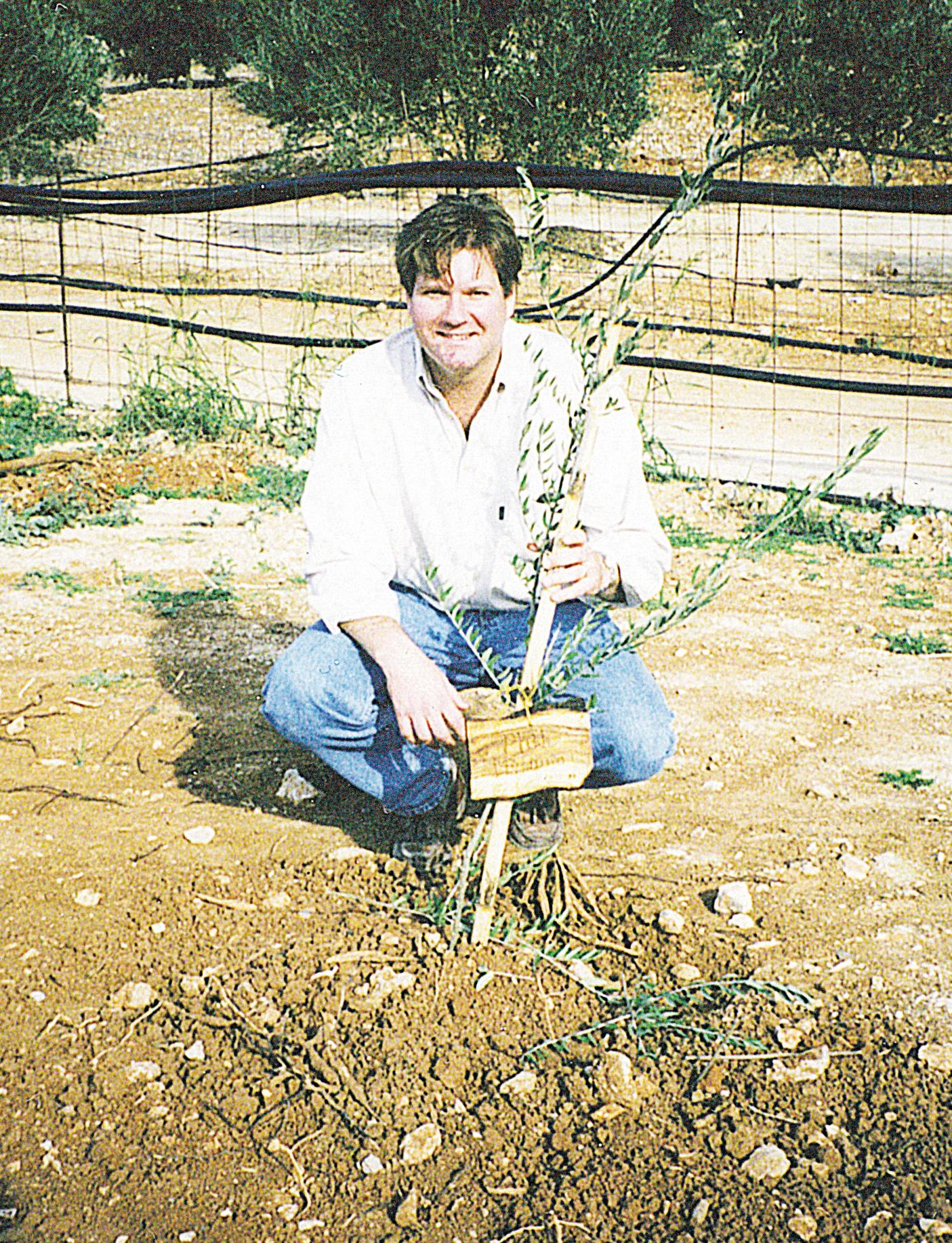 Phil planting a tree.jpg
